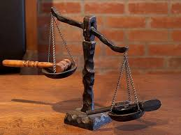 photo shows a judge's scales