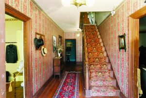 Photo shows the narrow staircase in the William Heath Davis House, where the Victorian couple is said to stand.